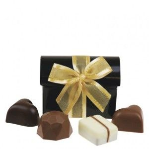 A shipper of 19 Treasure Chest Black. Gorgeous black treasure chest shaped gift boxes, filled with four assorted chocolates.