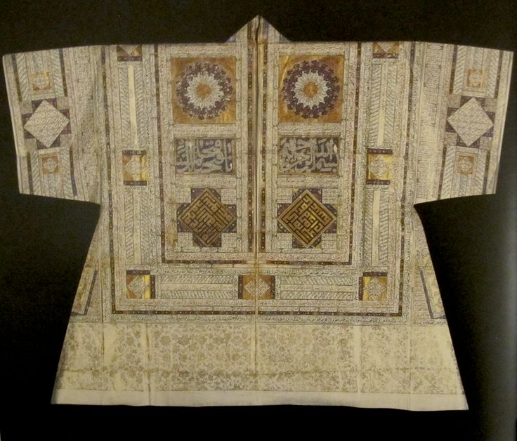 'Tılsımlı Gömlek / Talismanic shirt'. Collarless shirt made of white, tightly-woven and thin linen. Decorated with various suras and verses from the Koran, together with magical letters and numbers used in forecasting the future. Ottoman, 15th or 16th century. (Topkapi Palace Museum / Imperial Wardrobe Collection).