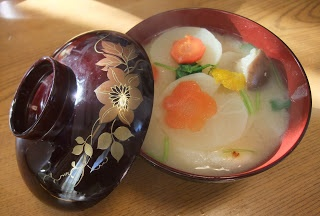 Traditional Japanese New Year dishes. Zouni (Rice cake in white miso soup)  )