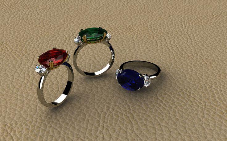 ANILLOS AVANTGARDE Colección realizada con los materiales más nobles. Las monturas de estos tres anillos, dan el protagonismo a tres gemas de color, el zafiro, el rubí y la esmeralda abrazadas con doble grapa y custodiadas por diamantes talla oval.