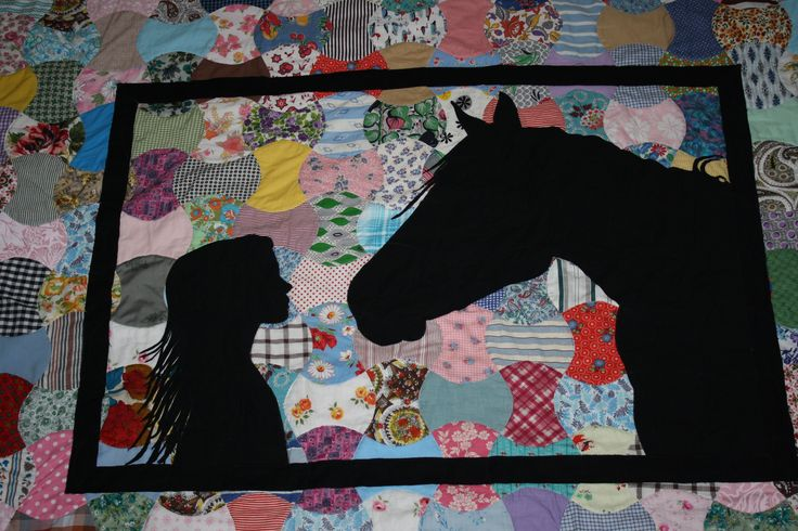 My Niece and her horse. Applique onto a vintage hand-pieced apple core pattern quilt. Believed to be of 1930s-40s fabric.