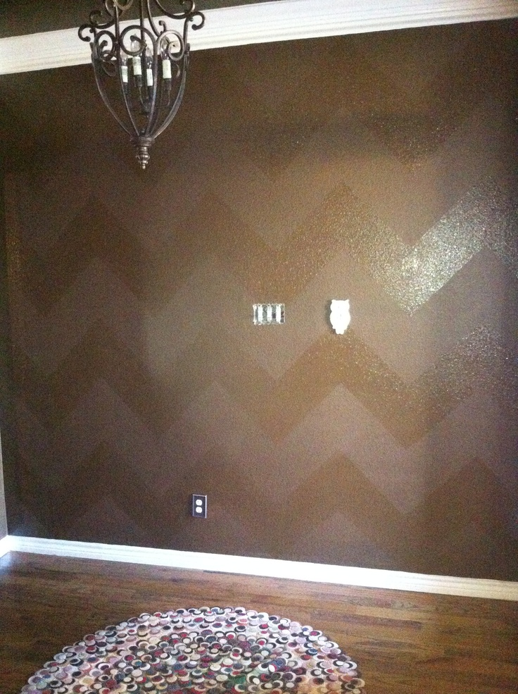 Chocolate chevron striped wall using satin paint and high gloss polyurethane.  Turned out perfect in my entrance. Now for a Turquoise church pew!