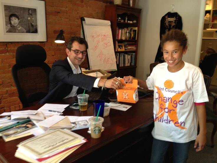 Joint Council President & CEO Tom DiFilipo with our Director of Orphan Nutrition's beautiful adopted daughter showing off the Make Change for Children gear!