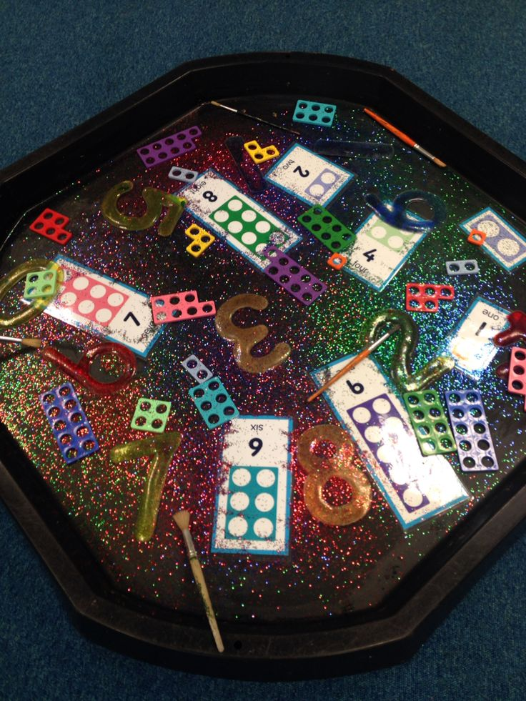 Numicon, gel numbers and glitter! Children used the paintbrshes to practice…