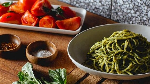 Sicilian pesto and warm tomato salad make a light summer meal that happens to be vegetarian.