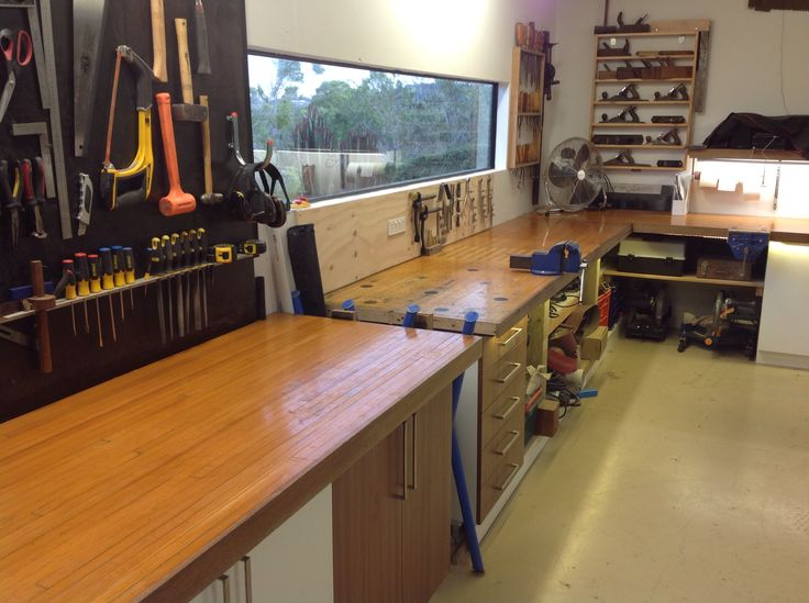 Woodworking workshop bench using recycled bowling alley timber. Shadow board, chisel board and wood planes on display.