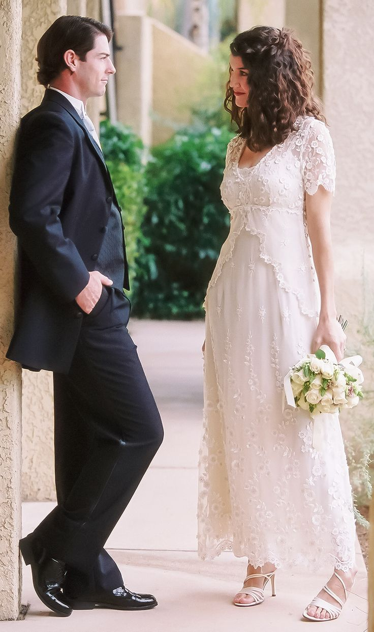 Emma by Martin McCrea | Embroidered European lace overdress with a button-up closure on the side. Delicate cap sleeves. Underneath is a stretch silk charmeuse slip dress. This wedding dress has an empire waist for a flattering fit on any figure. Available in plus size and custom sizes.