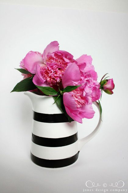 Black white stripes and pink flowers work amazingly we'll together.