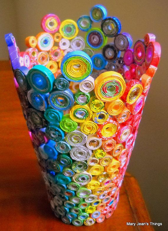 Upcycled Rainbow Vase Sculpture made from Magazines, Candy Wrappers, Catalogs & Coupon Circulars    This Rainbow colored Vase is made entirely from PAPER! I carefully cut each strip of paper, roll the strips into paper reeds, roll the reeds into paper wheels, glue them all together, and add an extra coat of special paper glue to the interior for durability. The paper I used is collected from magazines, candy wrappers, catalogs, newspaper sale pages and coupon circulars. There are a few foil…