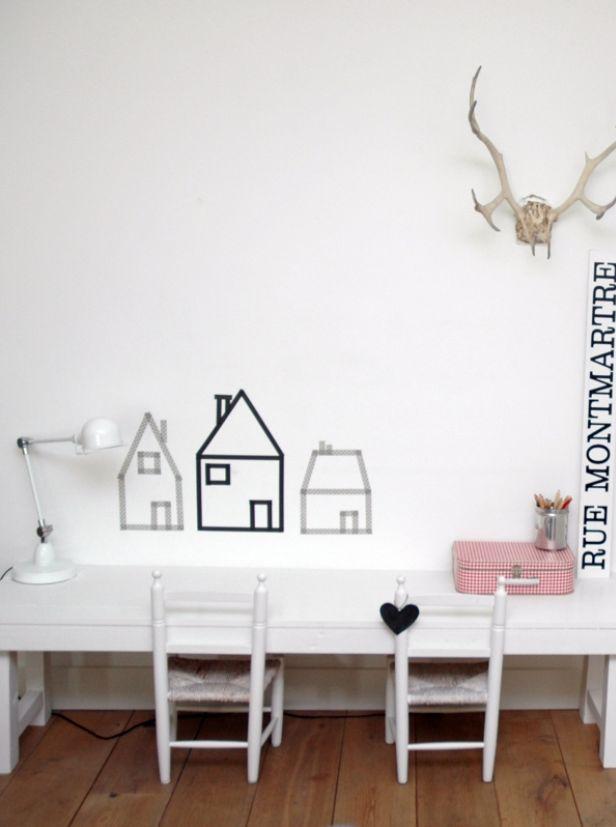 Huisjes van washi tape op de muur