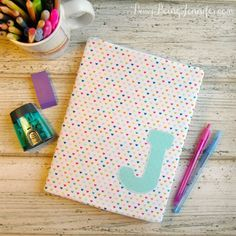 Make your own DIY Notebook Cover for a fun, practical and reusable way to cover those boring old composition notebooks!