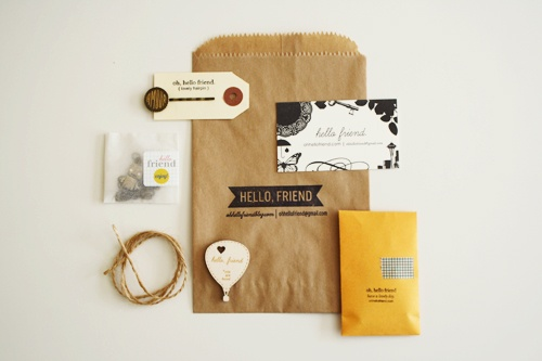 Sweet and simple packaging.  There;s nothing like a brown bag, some twine, fun font and a pop of color.