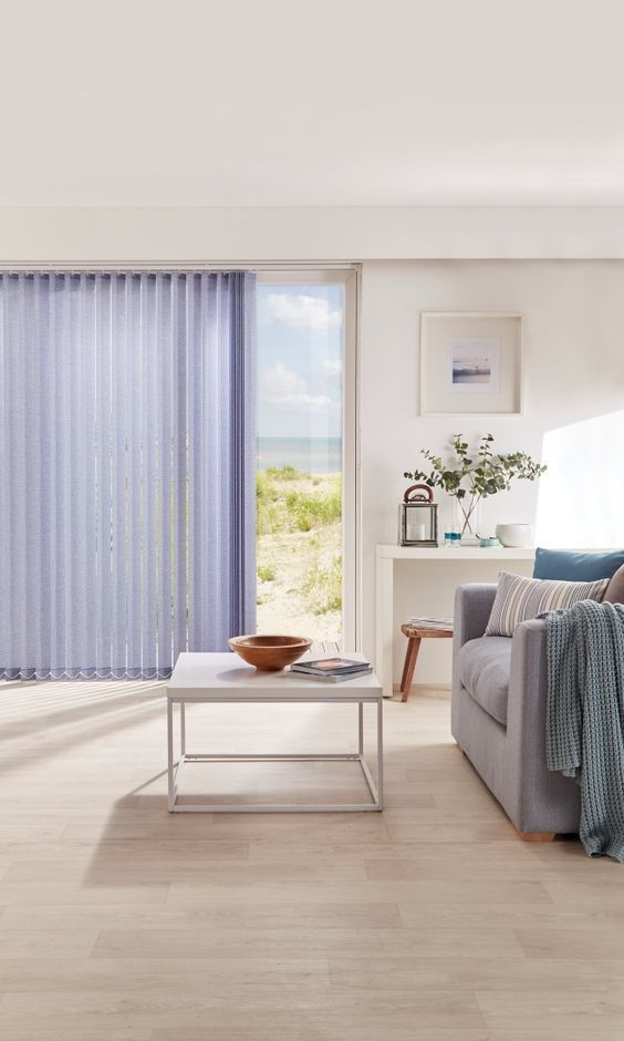 Hues of grey, cream and blue create a wonderful coastal feel to a room. Use ash coloured wood with stripes and chunky textures to bring the look together, add coastal themed accessories to finish the look off. Made to measure Vertical blinds are a brilliant accompaniment to this look.
