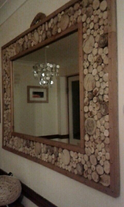 We made the mirror frame then decorated it with sliced wood.