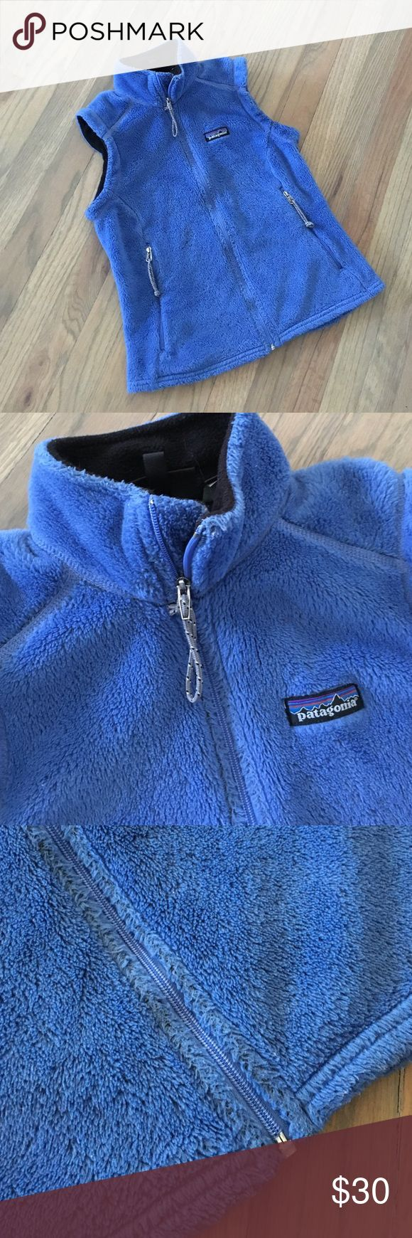 "Patagonia fleece vest This vest has been loved dearly but there is still lots of life left. Perfect for a petite lady. Pit to pit: 16"", total length: 20"". Good used condition. Wear present. Patagonia Jackets & Coats Vests"