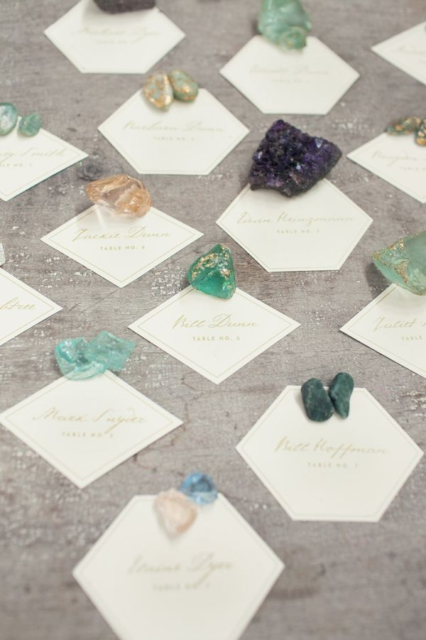 place geometric escort cards down with various rocks and gems //