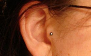 Tragus. Want. but a diamond instead of a ball :) mommy WiLL kill me if i get it lol