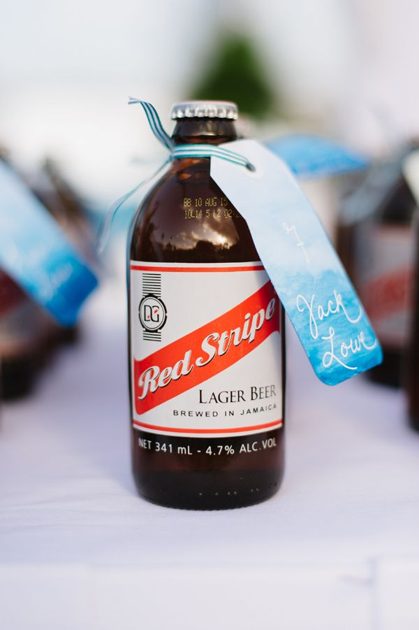 Red Stripe beer escort cards with hand painted luggage tags