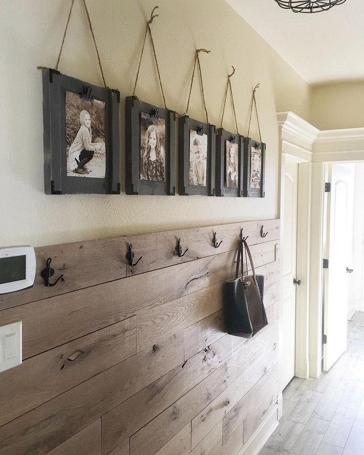 My new hallway all finished up... this is probably the most used space in my home actually... I decided to plank the walls with old barn wood from @reclaimeddesignworks ... the hooks are from Ikea and we are sharing a video soon for the frames! #shanty2chic #diy #hallway #reclaimedwood