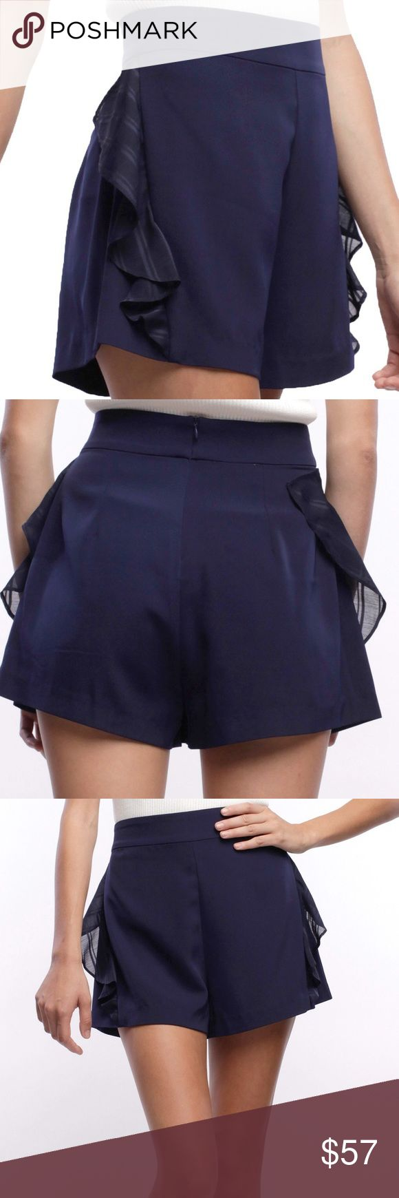 "Oscar shorts by Line + Dot Navy blue high waisted shorts.""SELF-97% POLYESTER 3% SPAN LINING-100% POLYESTER"" Designed in Sunny California. Imported. Dry clean only. Price Firm Line & Dot Shorts"