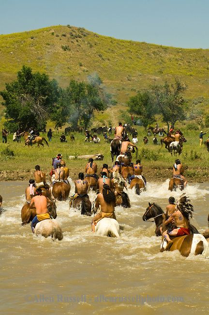 Custers Last Stand Reenactment, Battle of the Little Bighorn, Crow Native American Reservation, Montana, Custer and 7th Cavalry battle indian warriors. Allen Russell photography