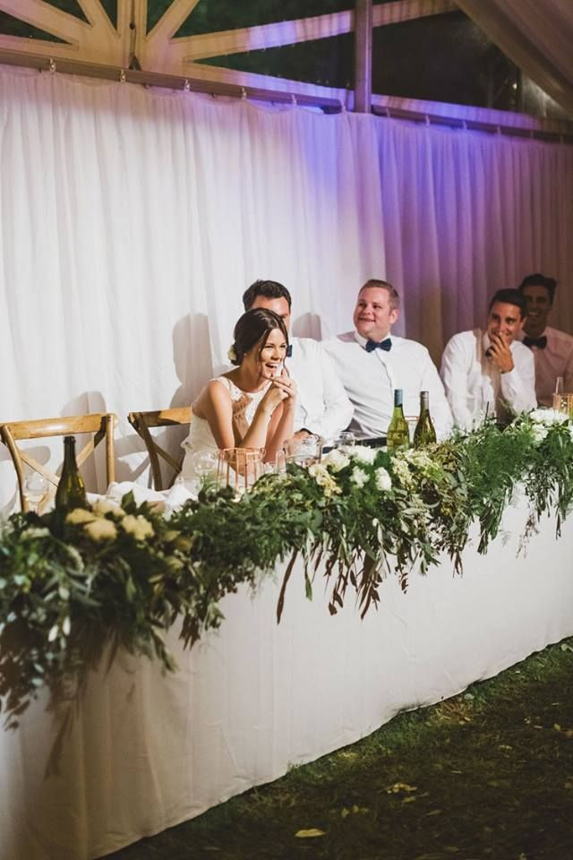 Head table with lots of greenery garland