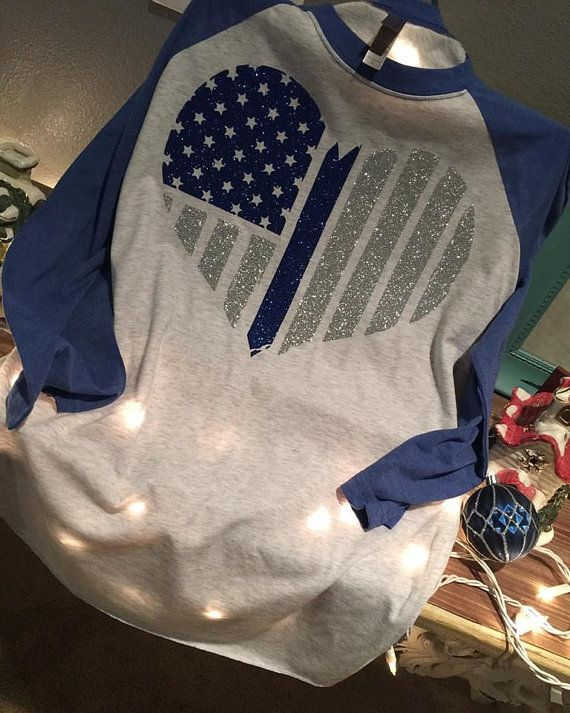 Beautiful beautiuful poilce lives matter in glitter detail baseball tee! so comfortable and amazing glitter detail! no better way than to show your support in our men and woman in uniform ! Also dont forget to also order your matching thin blue line hat! **HAT NOT INCLUDED