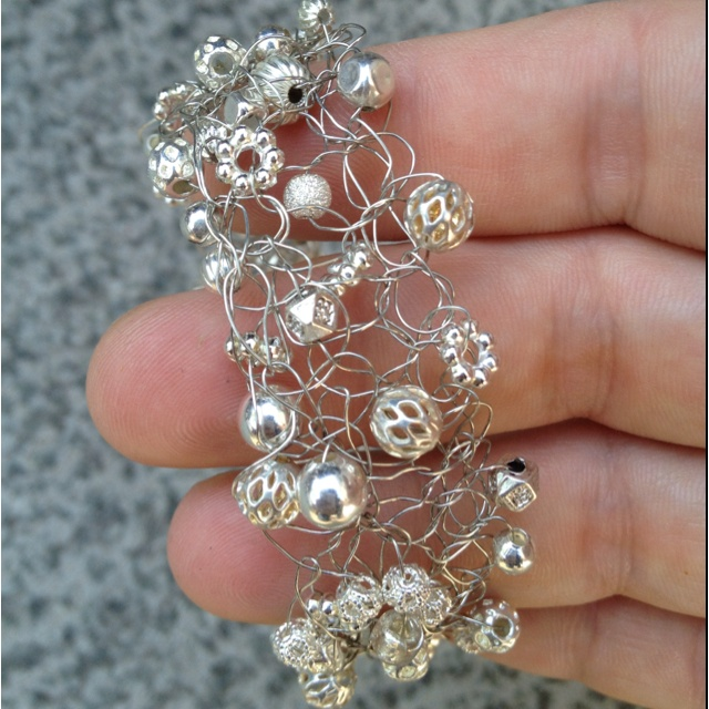 Wire crocheted bracelet with various silver colored beads. $35.00 >> SOLD!