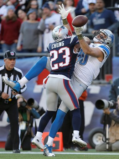 New England Patriots safety Patrick Chung breaks up
