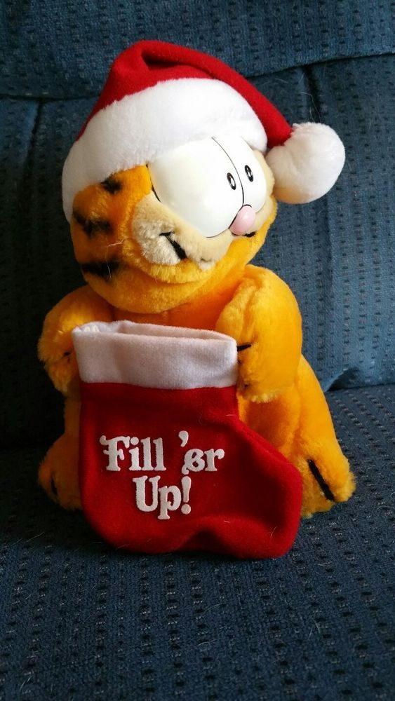 Christmas Garfield holding stocking with Santa hat on