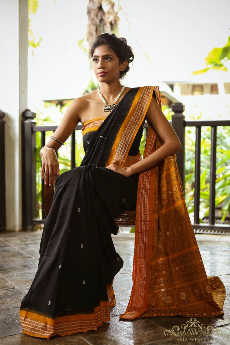 A fully hand woven BOMKAI from Orissa in Black & Mustard https://www.facebook.com/pages/Asia-Weaves/208596629275885