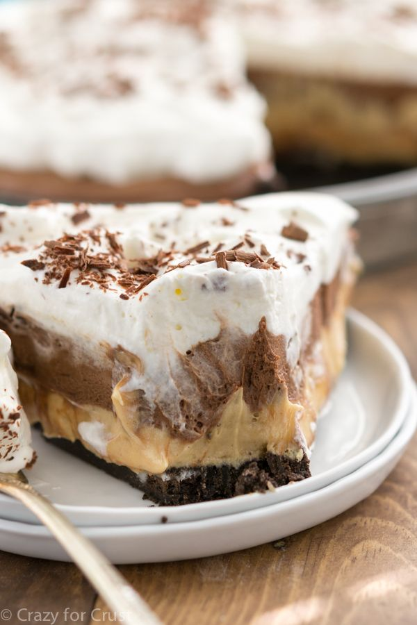 Chocolate Peanut Butter Cream Pie -- Oreo Crust topped with fluffy Peanut Butter Filling, Gooey Chocolate and Whipped Cream