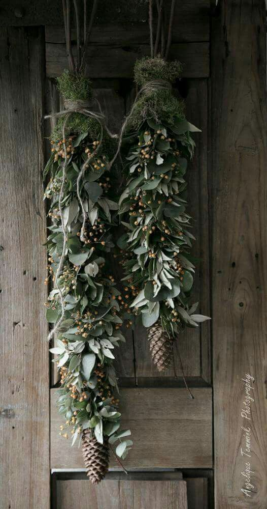 Holidays Naturally | Eucalyptus, pine and pinecones tied with jute for door ornamentation