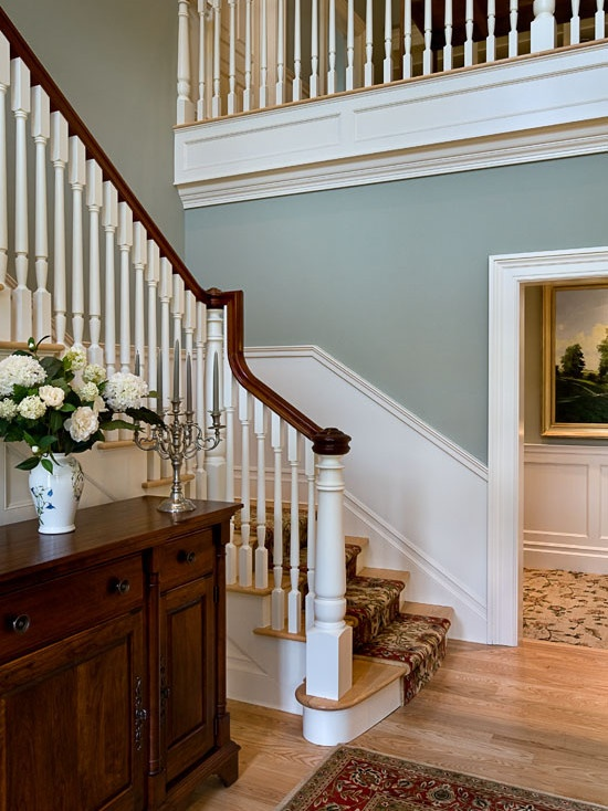 Alot of people push the hall way to the back of their list, i love a bright white stair case with this colour for the walls. People see your hall way before anything else!