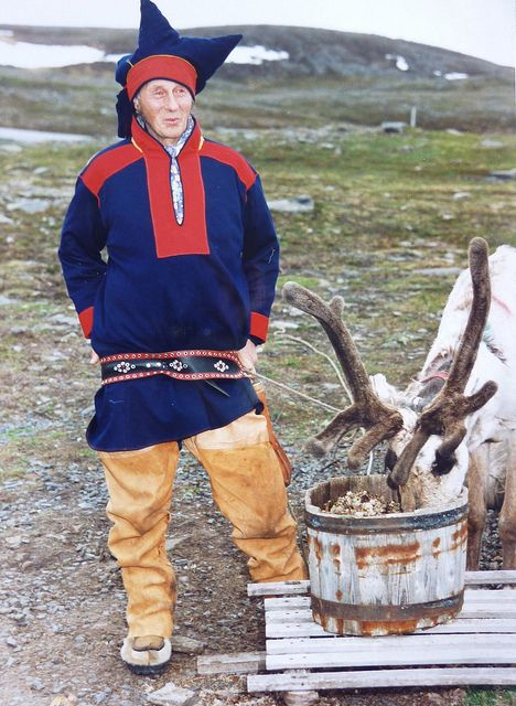A Sami reindeer herder on the North Cape of Norway. Reindeer herding goes back thousands of years and the Sami wear very colourful costumes.