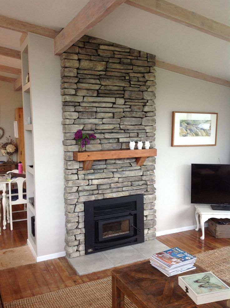 Fireplace With Stone Work And Mantel Piece Tiles Used For