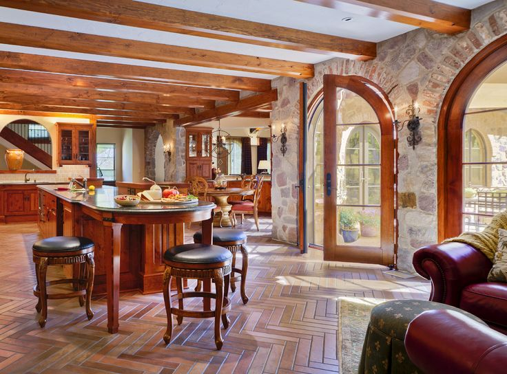 Tuscan Kitchen (Cultivate.com)  love the stone walls, arched doors & ceiling beams