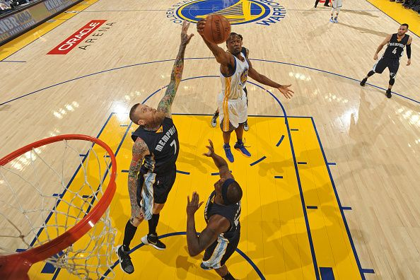 Harrison Barnes of the Golden State Warriors grabs a rebound over Memphis Grizzlies forward Chris Andersen on April 13 2016 at Oracle Arena in...