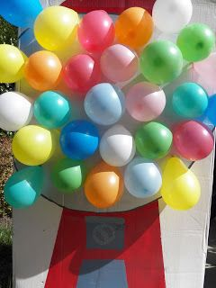 Easy balloon pop carnival game made from a cardboard box. Painted to look like a gumball machine and the balloons are the gumballs!