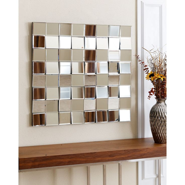 Give your home or office a new look with the Isabella square wall mirror from Abbyson Living. This stunning accent features distinct angles and a contemporary design that is sure to elevate the look and feel of any room.
