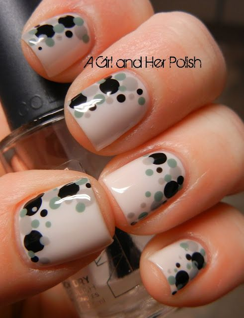 Black and grey spotted nails