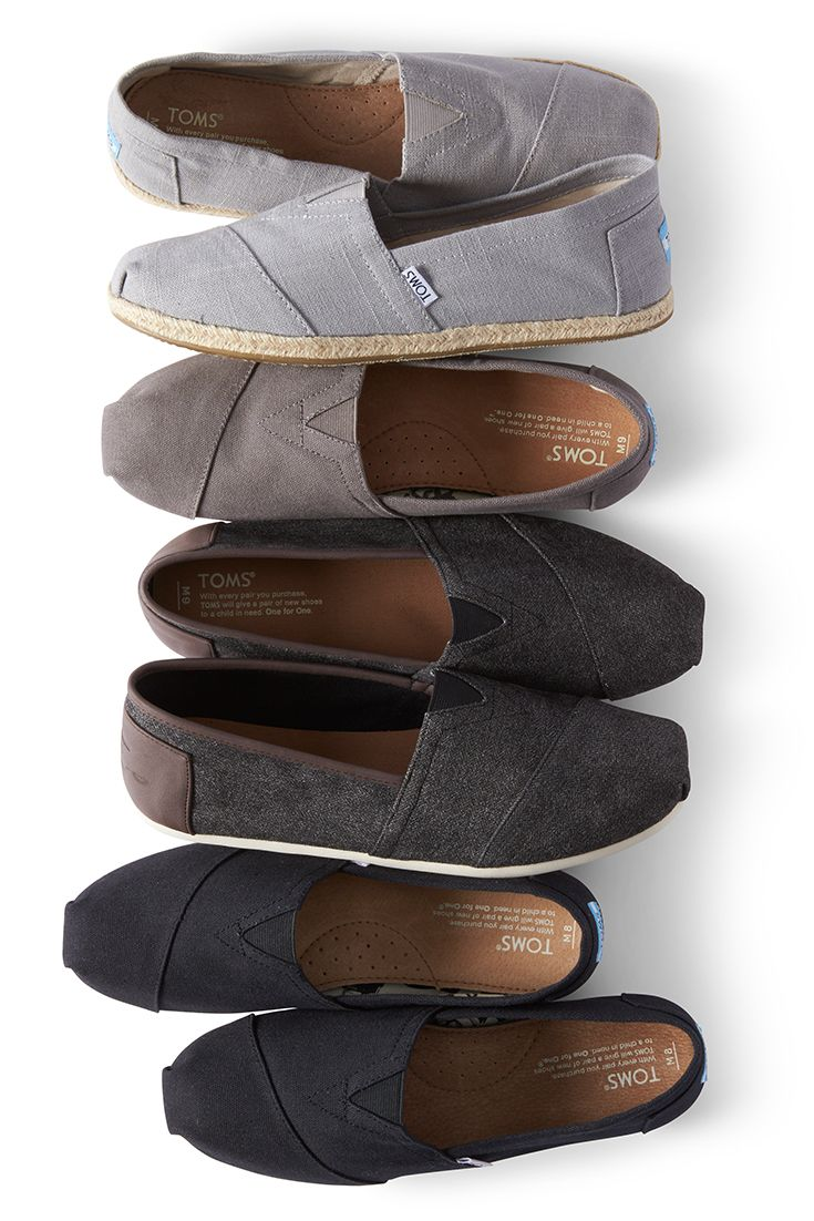 Click to shop TOMS slip-on shoes for men in black, herringbone, charcoal or grey.