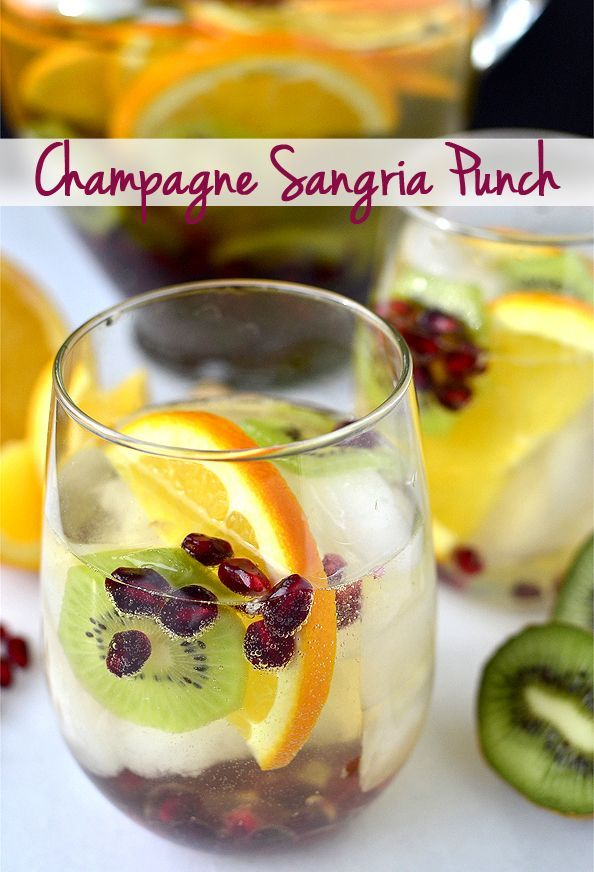 Champagne Sangria Punch Recipe ~ Bubbly champagne is mixed with wine-soaked winter fruits including kiwi, oranges, and pomegranate arils, then finished with a splash of orange juice to sweeten each sip.