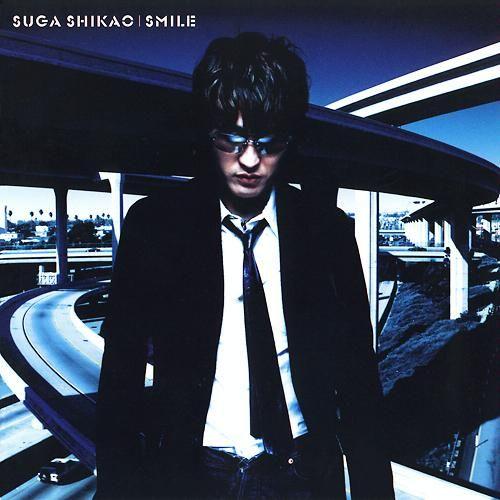 Suga Shikao - SMILE  Tracklist 1. Thank You 2. Asymmetry (アシンメトリー) 3. Yuutousei (優等生) 4. Sakura Namiki (桜並木) 5. Aozora (album version) (青空 (album version)) 6. Go! Go! 7. Sayonara (album version) (サヨナラ (album version)) 8. Adayume (あだゆめ) 9. Hajimete no Kimochi (はじめての気持ち) 10. Kimagure (album version) (気まぐれ (album version))  Bonus Disc Tracklist 1. Bokutachi no Hibi (ぼくたちの日々) 2. THEME OF FAMILY SUGAR