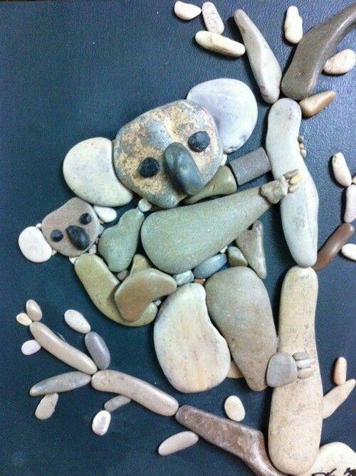 Beautiful a koala his baby handclips a stone