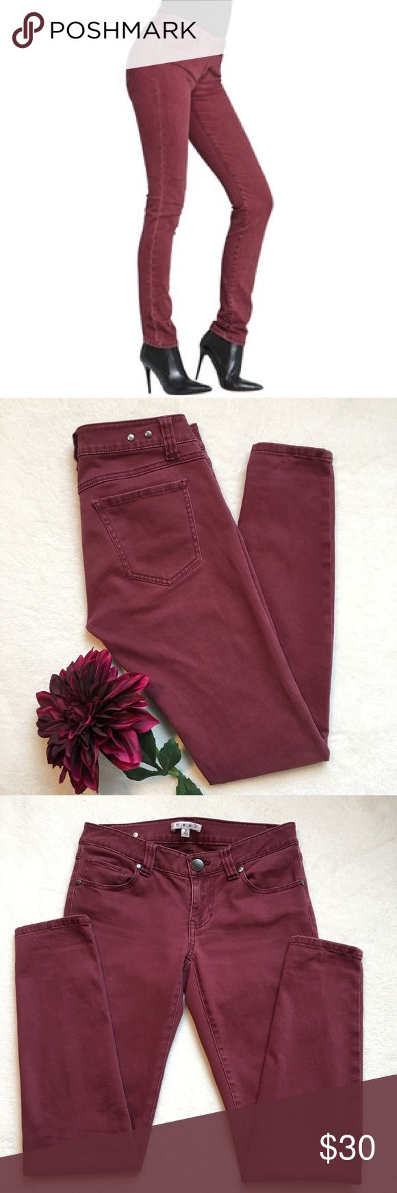 """{CAbi} Bordeaux Skinny Jeans CAbi Bordeaux skinny jeans. A cotton blend softens these flattering skinny jeans, rendered in a sophisticated hue. 15"""" flat across waist. 7"""" front rise. 30"""" inseam. 90% cotton 8% elasterell 2% spandex. Good preloved condition. CAbi Jeans Skinny"""