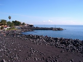 San Giovanni Li Cuti, a small and nice beach very close to the center of the city: its characteristic is the color of the sand, as it is composed by lava sand and stones from Etna's eruption. Very original :-)
