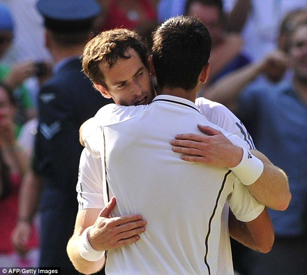 An exhausted Murray embraces opponent Novak Djokovic after the heroic straight sets win