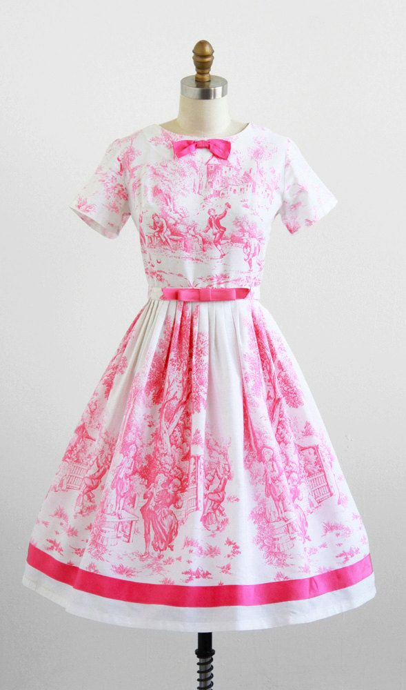 I love beyond love this gorgeous 1950s pink and white toile day dress with bow belt. #vintage #fashion #1950s