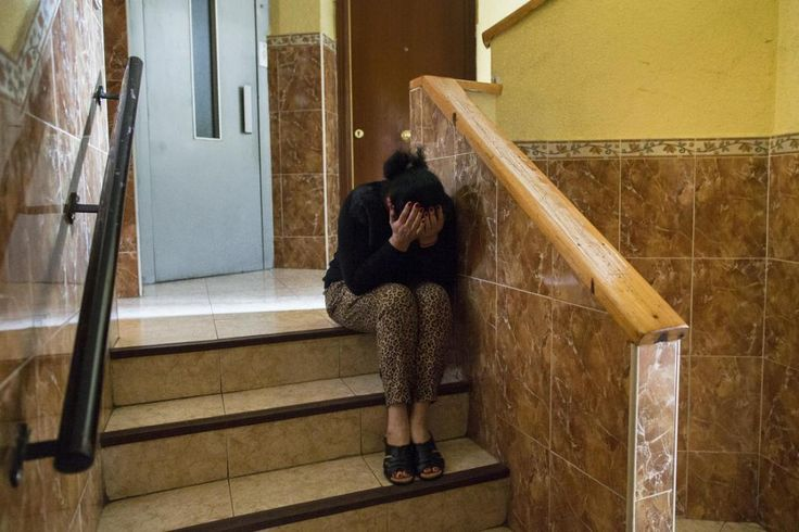 C, 59 years old, cries as she waits for the police to evict her son,  39, and his family in Madrid, Spain, Monday, May 19, 2014. E and his 30 year old wife, have 5 children and they occupied a Banco Popular bank apartment over a year ago and they cannot afford to pay the rent with a low income of 600 euros ($823) a month. 1/23/15